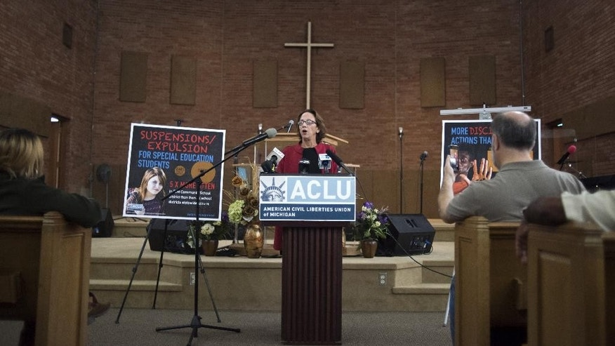 Kary Moss, Executive Director of the ACLU of Michigan, speaks at the Saints of God Church Tuesday, Oct. 18, 2016, in Flint, Mich. Several families have filed a class-action lawsuit against the state of Michigan and the Flint school district, saying more needs to be done to help students whose academic performance and behavior have worsened since drinking the city's lead-tainted water. (Mark Felix/The Flint Journal-MLive.com via AP)