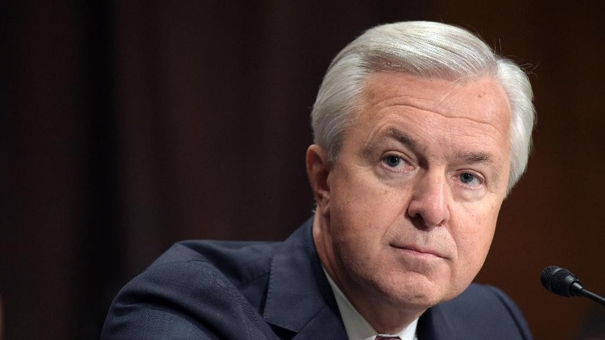 In this Sept. 20, 2016, file photo, Wells Fargo CEO John Stumpf testifies on Capitol Hill in Washington, before the Senate Banking Committee. California Attorney General Kamala Harris announced she has launched a criminal investigation into the sales practices of Wells Fargo, on Wednesday, Oct. 19, 2016. (AP Photo/Susan Walsh, File)