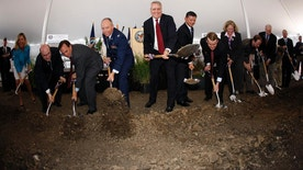 FILE - In this Aug. 22, 2009 file photo, Eric Shinseki, the now-former secretary of the Veterans Administration, sixth from left, joins then-Colorado Gov. Bill Ritter, fifth from left, and a host of local and state officials in breaking ground during a ceremony for a state-of-the-art veterans medical center, in Aurora, Colo. Government investigators said Wednesday, Oct. 19, 2016 they are looking into an allegation that Veterans Affairs Department employees in Colorado kept unofficial lists of veterans waiting for health care, which could conceal how long it takes to get an appointment. The inquiry could broaden a nationwide scandal over the use of unofficial or secret lists to hide lengthy delays in care for veterans. (AP Photo/David Zalubowski, file)