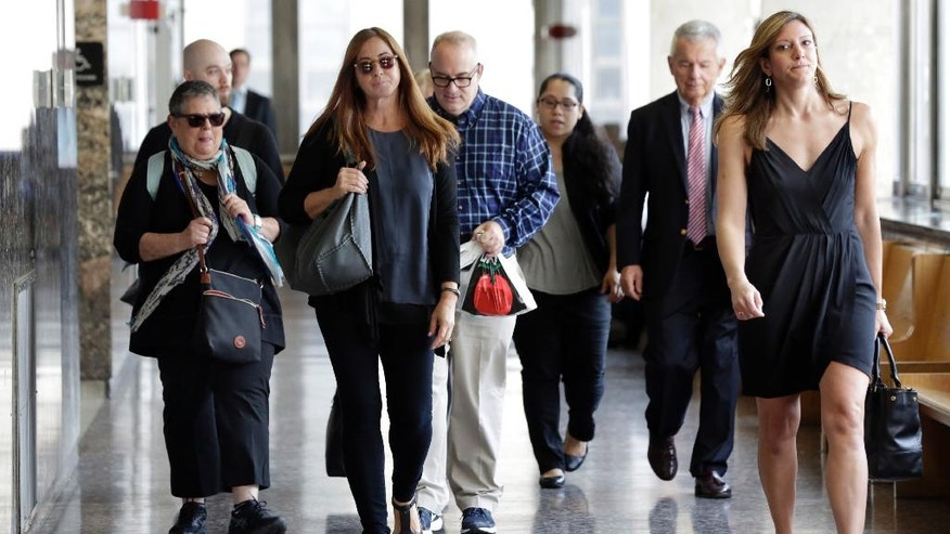 A group of former jurors in the first trial of Pedro Hernandez arrive at court in New York, Wednesday, Oct. 19, 2016. Opening statements are set for Wednesday in a retrial surrounding the 1979 disappearance of Etan Patz. (AP Photo/Richard Drew)