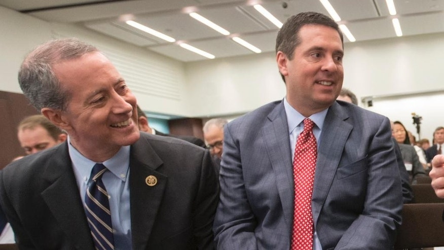 FILE - In this June 9, 2016, file photo, House Intelligence Committee Chairman Rep. Devin Nunes, R-Calif., right, and House Armed Services Committee Chairman Rep. Mac Thornberry, R-Texas, left, talk in Washington. Russia's violation of a key nuclear arms control treaty has become more egregious, Nunes and Thornberry said in a letter released Oct. 19, that urged the Obama administration to confront and impose penalties against Moscow. (AP Photo/J. Scott Applewhite, File)