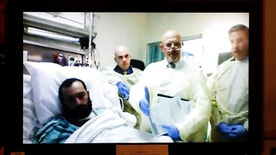 FILE - In this Oct. 13, 2016, file photo, Ahmad Khan Rahimi, left, appears via video from his hospital bed in Newark, N.J., during a court hearing at the Union County Courthouse, in Elizabeth, N.J. Rahimi, accused of setting off bombs in New Jersey and New York was moved from a hospital to a state prison Tuesday, Oct. 18, according to the New Jersey Corrections Department spokesman. (Union County Courthouse via AP, Pool, File)