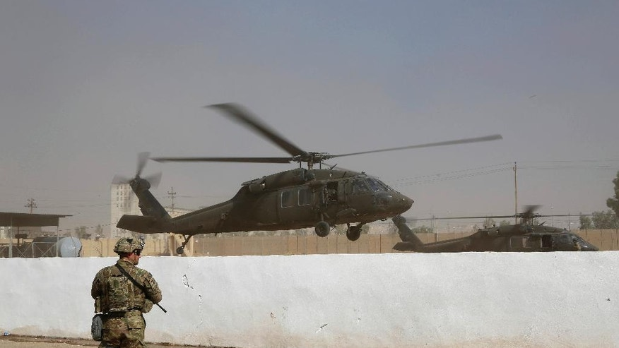 A helicopter belonging to the international coalition forces takes off from a base outside Mosul, Iraq, Wednesday, Oct. 19, 2016. The U.S. has just as much to gain from the operation to recapture Mosul as the Iraqis themselves. Since 2014, the U.S. has provided airstrikes and advise-and-assist operations to put the beleaguered Iraqi military back on its feet after the Islamic State group gutted it of weapons, supplies and soldiers during its blitzkrieg across Iraq and Syria. (AP Photo)