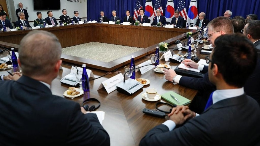 South Korean Defense Minister Han Min-koo, South Korean Foreign Minister Yun Byung-se, listen as Secretary of State John Kerry speaks, with Defense Secretary Ash Carter before a meeting at the State Department in Washington, Wednesday, Oct. 19, 2016. (AP Photo/Alex Brandon)