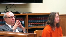 FILE - In this Aug. 20, 2015, file photo, Brittany Pilkington, right, and her attorney Marc Triplett, left, listen as a judge sets a $1 million bond in her case during a hearing in Bellefontaine, Ohio.  An Ohio judge is reviewing recorded police interviews of  Pilkington, a woman accused of suffocating her three young sons, as he considers her lawyers' request to exclude her confession. Her trial is scheduled for late February.  (AP Photo/Andrew Welsh-Huggins, File)