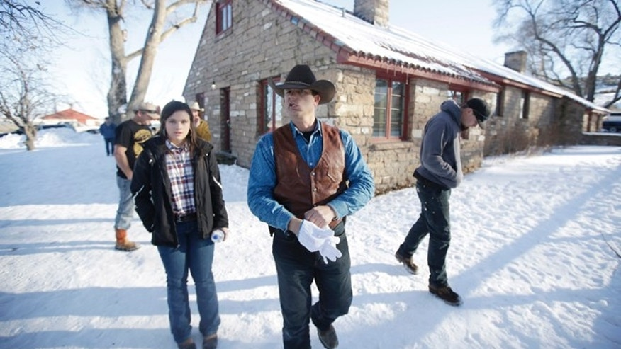JANUARY 2016: Ryan Bundy, center, one of the sons of Nevada rancher Cliven Bundy, walks through the Malheur National Wildlife Refuge near Burns, Ore. I