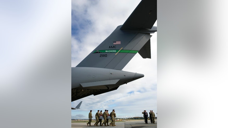 An Army carry team moves a transfer case containing the remains of Army Sgt. Douglas Riney, 26, of Fairview, Ill., Friday, Oct. 21, 2016, at Dover Air Force Base, Del. According to the Defense Department, Riney died Oct. 19 in Kabul, Afghanistan, of wounds received from encountering hostile enemy forces while supporting Operation Freedom's Sentinel. (AP Photo/Cliff Owen)
