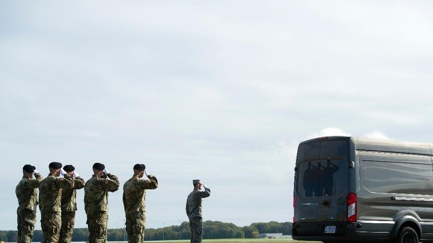 An Army carry team salutes as the remains of Army Sgt. Douglas Riney, 26, of Fairview, Ill., leave the flight line in a transfer vehicle, Friday, Oct. 21, 2016, at Dover Air Force Base, Del. According to the Defense Department, Riney died Oct. 19 in Kabul, Afghanistan, of wounds received from encountering hostile enemy forces while supporting Operation Freedom's Sentinel. (AP Photo/Cliff Owen)