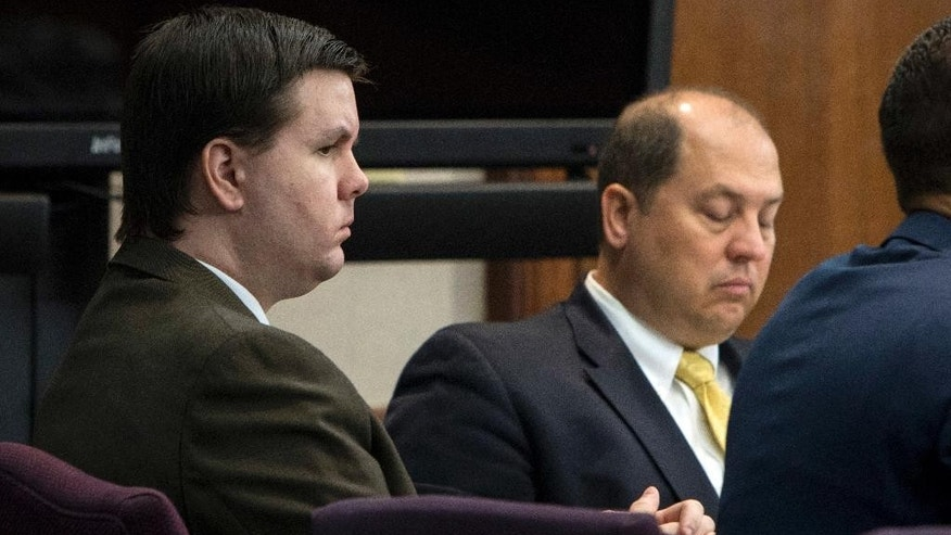 FILE - In this Oct. 3, 2016 file photo, Justin Ross Harris, left, listens to jury selection during his murder trial at the Glynn County Courthouse in Brunswick, Ga.  Harris, 34, is charged with murder in the death of his 22-month-old son, Cooper. He's also charged with sending graphic, sexual text messages and photos to a girl for a period of several months when she was 16 and 17.   (Stephen B. Morton/Atlanta Journal-Constitution via AP, Pool)