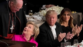 Republican presidential candidate Donald Trump, second from right, and his wife Melania Trump, right, watch as Democratic presidential candidate Hillary Clinton, second from left, is helped into her chair by Cardinal Timothy Dolan, Archbishop of New York, left, after speaking at the 71st annual Alfred E. Smith Memorial Foundation Dinner, a charity gala organized by the Archdiocese of New York, Thursday, Oct. 20, 2016, at the Waldorf Astoria hotel in New York. (AP Photo/Andrew Harnik)