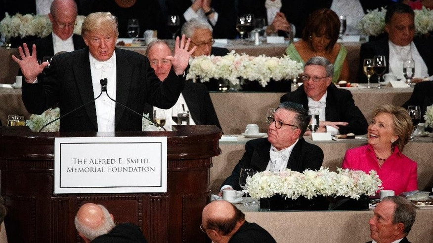 Democratic presidential candidate Hillary Clinton, right, reacts as Republican presidential candidate Donald Trump speaks during the Alfred E. Smith Memorial Foundation dinner, Thursday, Oct. 20, 2016, in New York. (AP Photo/ Evan Vucci)