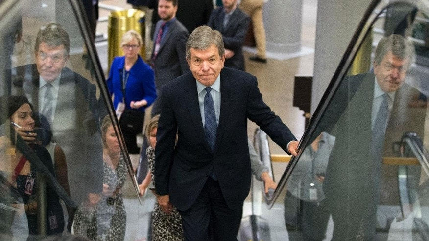 FILE - In this June 21, 2016, file photo, Sen. Roy Blunt, R-Mo., rides an escalator on Capitol Hill in Washington. The clamor for change that's fueling Donald Trump's presidential campaign may help Jason Kander, a little-known Democrat, upset powerful Republican Sen. Roy Blunt in red-state Missouri on Election Day. And with just a few competitive Senate races around the country, the outcome in Missouri could help determine which party controls the Senate (AP Photo/Alex Brandon, File)