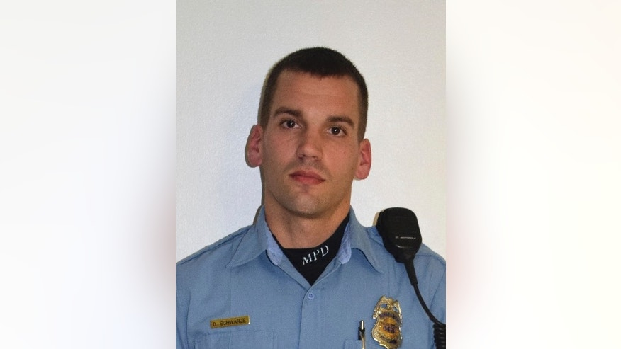 This undated photo provided by the Minneapolis Police Department shows Dustin Schwarze. Officers Schwarze and Mark Ringgenberg, two white police officers, were involved in the fatal shooting of a black man last fall. The officers followed proper procedure in a confrontation that led to the fatal shooting of Jamar Clark in November, and won't face discipline, the city's police chief announced Friday, Oct. 21, 2016.  (Minneapolis Police Department via AP)