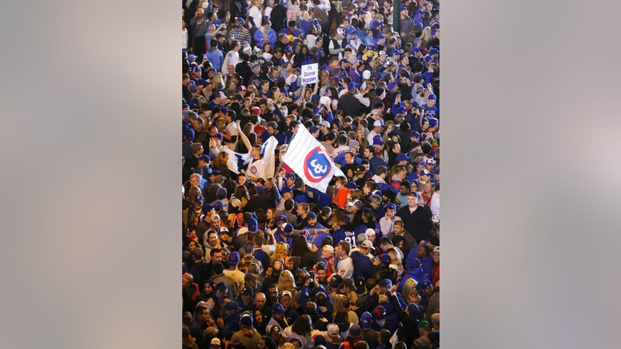 Chicago Cubs fans celebrate on the street outside Wrigley Field after Game 6 of the National League baseball championship series against the Los Angeles Dodgers, Saturday, Oct. 22, 2016, in Chicago. The Cubs won 5-0 to win the series and advance to the World Series against the Cleveland Indians. (AP Photo/Charles Rex Arbogast)
