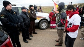 Dakota Access Pipeline protesters square off against police between the Standing Rock Reservation and the pipeline route outside the little town of Saint Anthony, North Dakota, U.S., October 5, 2016. REUTERS/Terray Sylvester - RTSQYAS