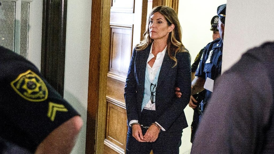 Former state Attorney General Kathleen Kane leaves court in handcuffs after her sentencing at the Montgomery County Courthouse in Norristown, Pa., Monday, Oct. 24, 2016. Kane is sentenced to 10-to-23 months in county prison and 8 years probation. In August, Kane was found guilty of felony perjury and an assortment of misdemeanors related to a leak of secret grand jury materials.   (Dan Gleiter/PennLive.com via AP, Pool)