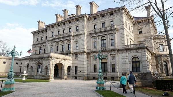 FILE - In this Dec. 1, 2014, file photo, visitors walk toward an entrance to The Breakers mansion in Newport, R.I. The battle over the Vanderbilt mansion, The Breakers, goes before the Rhode Island Supreme Court Tuesday, Oct. 25, 2016. The nonprofit group that owns the spectacular mansion in Newport is planning to build a visitors center on its grounds. That plan is opposed by dozens of members of the Vanderbilt family and many preservationists, who say it would damage the integrity of the grounds. (AP Photo/Steven Senne, File)