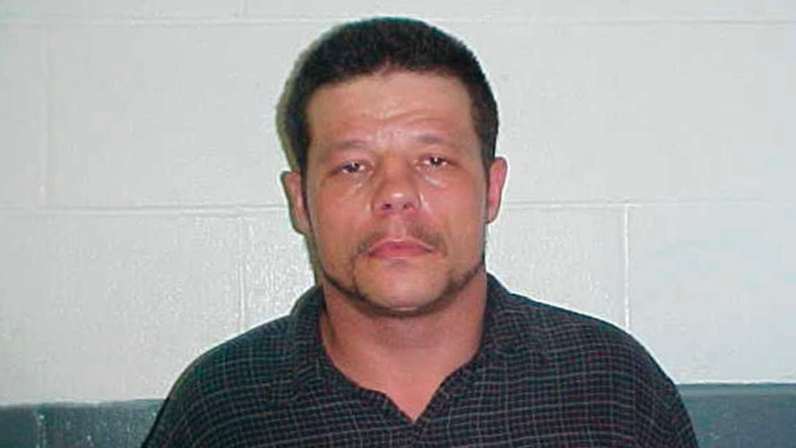 This June 8, 2010 photo provided by the Kay County Detention Center shows Michael Vance. Authorities are searching for Vance, who is suspected in a double slaying and accused of shooting and wounding multiple police officers near Oklahoma City on Sunday, Oct. 23, 2016. (Kay County Detention Center via AP)