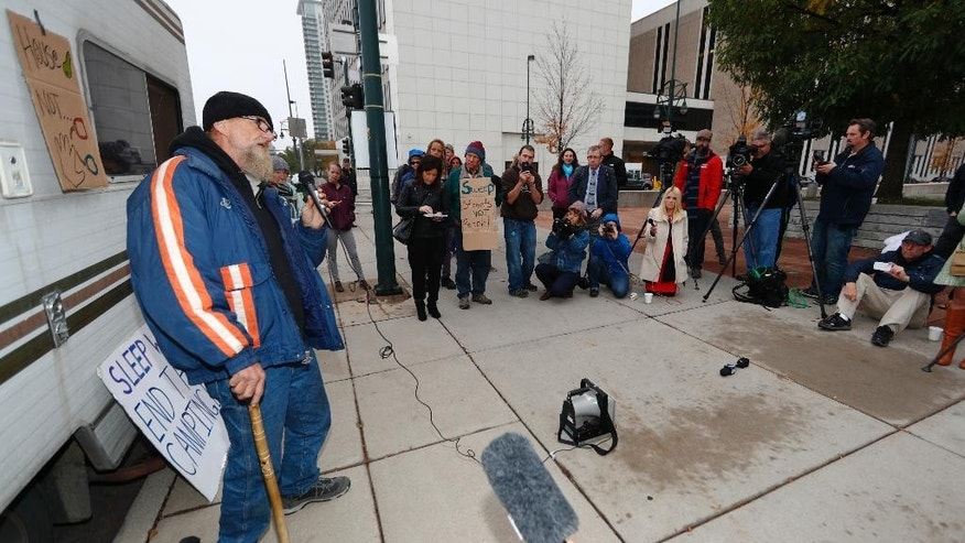 In this Wednesday, Oct. 12, 2016, photograph, Gary Anderson, who is homeless, speaks during a brief rally before entering the federal courthouse for a hearing in a class action lawsuit challenging the homeless sweeps in the Mile High City last spring in Denver. The lawsuit is the latest in a string of cases opposing crackdowns on people camping in public around the country. (AP Photo/David Zalubowski)