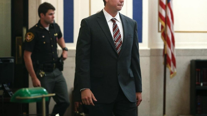 CORRECTS POOL SOURCE TO THE CINCINNATI ENQUIRER - Ray Tensing enters Judge Megan Shanahan's courtroom for his pre-trial hearing on Friday, Oct. 14, 2016, in Cincinnati. The former University of Cincinnati police officer is charged with killing Sam DuBose, an unarmed black man during a traffic stop over a missing front license plate.   (Amanda Rossmann /The Cincinnati Enquirer via AP, Pool)
