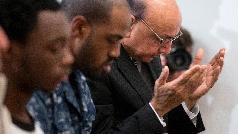 Khizr Khan, right, a Virginia Gold Star father, whose son Army Captain Humayun Khan was killed in Iraq saving his fellow soldiers, prays at a Mosque in Norfolk, Va., Wednesday, Oct. 26, 2016. Khan's Norfolk visit falls in the wake of a new Clinton campaign television ad that features him tearfully discussing the death of his Muslim-American son in Iraq.  (AP Photo/Steve Helber)