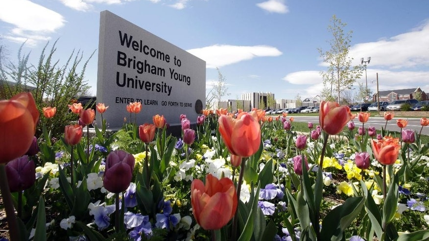 FILE - This April 19, 2016, file photo, shows a welcome sign to Brigham Young University in Provo, Utah. BYU announced Wednesday, Oct. 26, 2016, that students who report sexual assault will no longer be investigated for possible violations of the Mormon-owned school's strict honor code that bans such things as alcohol use.(AP Photo/Rick Bowmer, File)