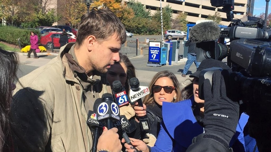Nathan Carman, speaks to reporters outside Saint Patrick - Saint Anthony Church in Hartford, Conn., Wednesday, Oct. 26, 2016, after a memorial service for his mother, Linda Carman, who was lost at sea. Nathan Carman was rescued by a freighter about 100 miles off the coast of Martha's Vineyard after the boat he and his mother were on sank during the weekend of Sept. 17.  (AP Photo/David Collins)