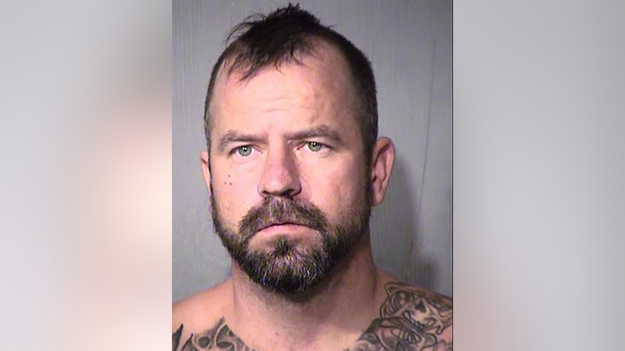 In this Thursday, Oct. 27, 2016 photo released by the Maricopa County Sheriff's Office, shows Joshua Adkins.  According to jail records,  Adkins was booked on suspicion of unlawful flight from law enforcement, aggravated assault-domestic violence and unlawful imprisonment. (Maricopa County Sheriff's Office via AP)