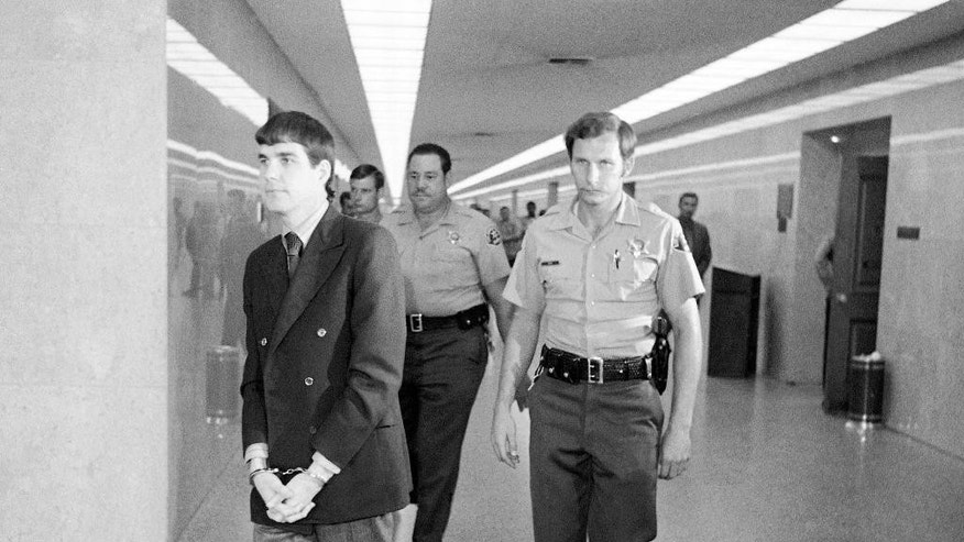 "FILE - In this Oct. 12, 1971 file photo, Charles ""Tex"" Watson, left, is led back to jail from a courtroom after he was convicted of seven counts of first degree murder and one of conspiracy to commit murder in the Tate-LaBianca slayings, in Los Angeles. California officials have denied parole for Watson, the self-described ""right-hand man"" of murderous cult leader Charles Manson. The decision came Thursday, Oct. 27, 2016, at the 17th parole hearing for Watson and 47 years after he helped plan and participated in the slayings of pregnant actress Sharon Tate and six others in 1969. (AP Photo/George Brich, File)"