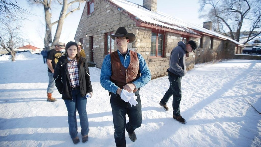 FILE - In this Jan. 8, 2016, file photo, Ryan Bundy, one of the sons of Nevada rancher Cliven Bundy, walks through the Malheur National Wildlife Refuge near Burns, Ore. The leaders of an armed group that took over a national wildlife refuge in rural Oregon have been found not guilty of conspiracy and possession of firearms at a federal facility. A jury on Thursday, Oct. 27, 2016, exonerated brothers Ammon and Ryan Bundy and five others of conspiring to impede federal workers from their jobs at the Malheur National Wildlife Refuge. (AP Photo/Rick Bowmer, File)