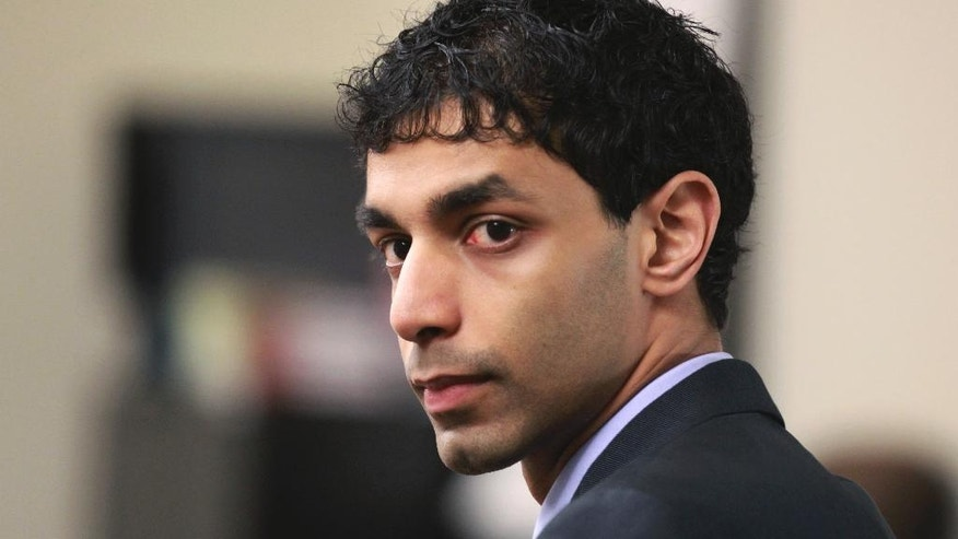 FILE – In this March 2, 2012, file photo, Dharun Ravi waits for his trial to begin at the Middlesex County Courthouse in New Brunswick, N.J.  Ravi, a former Rutgers University student, whose roommate Tyler Clementi killed himself in 2010 after being captured on a webcam kissing another man, pleaded guilty Thursday, Oct. 27, 2016, to attempted invasion of privacy, and was sentenced to probation and 30 days time served.  (John Munson/The Star-Ledger via AP, Pool, File)