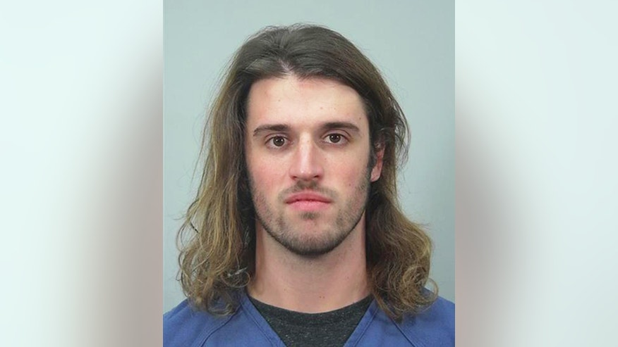 This undated photo provided by the Dane County Sheriff's Office in Madison, Wis., shows Alec Cook, a University of Wisconsin student charged with sexually assaulting and choking a woman.