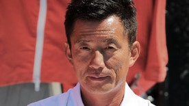 This undated photo provided by Guo Chuan Racing shows Guo Chuan. The U.S. Coast Guard in Hawaii was searching Wednesday, Oct. 26, 2016 for Guo Chuan, a Chinese mariner attempting to set a solo sailing record from San Francisco to Shanghai. The Coast Guard located his 97-foot trimaran on Tuesday about 600 miles northwest of Oahu but rescuers searching from the air saw no sign of him onboard. (Guo Chuan Racing via AP)