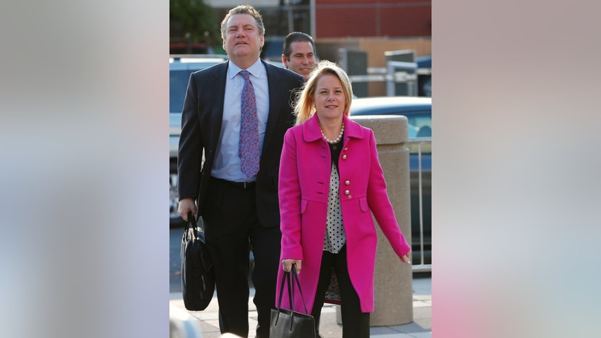 Bridget Kelly arrives with her attorneys at the federal courthouse in Newark, N.J., Friday, Oct. 28, 2016. After testimony spanning six weeks, jurors in the George Washington Bridge lane-closing case will hear closing arguments beginning today. Kelly and Bill Baroni, two former allies of Republican Gov. Chris Christie are on trial on charges they closed access lanes for four days in September 2013 to punish a Democratic mayor who didn't endorse Christie. (AP Photo/Rich Schultz)