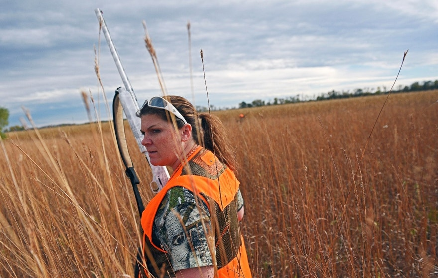 ADVANCE FOR SUNDAY OCT. 30 - In this Oct. 15, 2016 photo, Jen Schaeffer, of Sioux Falls, walks a piece of cover during the South Dakota pheasant hunting opener while hunting with Carol Bothe, of Brandon, S.D., on her family's farm near Brookings, S.D. The Argus Leader reports that the number of women obtaining pheasant hunting licenses in South Dakota has almost doubled in the last 10 years, reflecting a shift in culture and the success of hunting education programs. (Joe Ahlquist/The Argus Leader via AP)