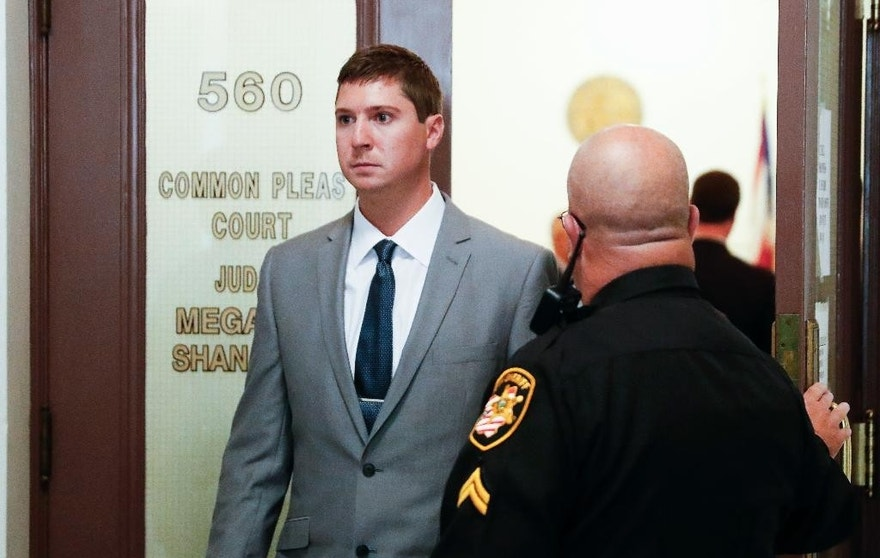 FILE - In this Oct. 25, 2016, file photo, Ray Tensing exits Hamilton County Common Pleas Judge Megan Shanahan's courtroom following the first day of the jury selection process for his murder trial in Cincinnati. Prospective jurors will be questioned Monday, Oct. 31 for Tensing's trial on murder and voluntary manslaughter charges in the shooting of Sam DuBose after he was pulled over July 19, 2015, near the University of Cincinnati for a missing front license plate. (AP Photo/John Minchillo, File)