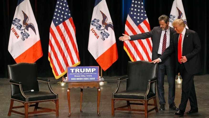 FILE - In this Sunday, Jan. 31, 2016 file photo, Jerry Falwell, Jr., left, president of Liberty University, guides Republican presidential candidate Donald Trump to his seat during a campaign event at the Orpheum Theatre in Sioux City, Iowa. Trump's candidacy has put a harsh spotlight on the fractures among Christian conservatives, most prominently the rift between old guard religious right leaders who backed the GOP nominee as an ally on abortion, and a comparatively younger generation who considered his personal conduct and rhetoric morally abhorrent. (AP Photo/Patrick Semansky)