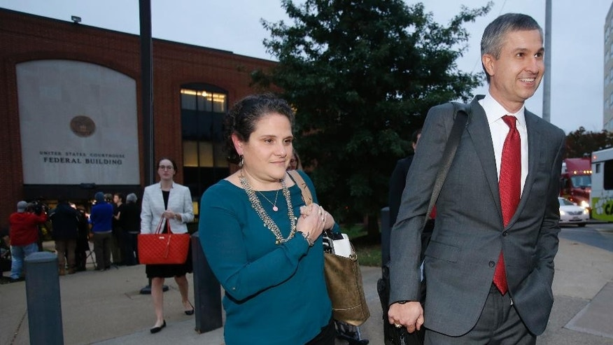 University of Virginia administrator Nicole Eramo, center, leaves federal court with her attorney Tom Clare, right, after closing arguments in her defamation lawsuit against Rolling Stone magazine in Charlottesville, Va., Tuesday, Nov. 1, 2016. Eramo is seeking $7.5 million from the magazine over its portrayal of her in the 2014 story by Sabrina Rubin Erdely. (AP Photo/Steve Helber)