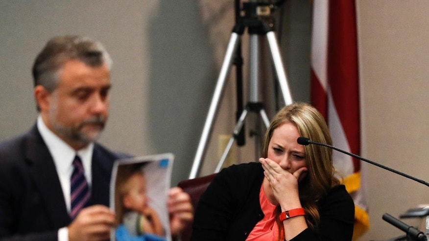 Leanna Taylor cries as defense attorney Maddox Kilgore shows the jury a picture of her son Cooper during a murder trial for her ex-husband Justin Ross Harris who is accused of intentionally killing Cooper in June 2014 by leaving him in the car in suburban Atlanta, Monday, Oct. 31, 2016, in Brunswick, Ga. (AP Photo/John Bazemore, Pool)