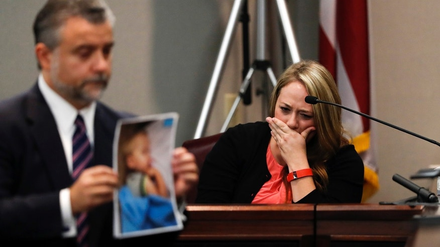 Oct. 31, 2016: Leanna Taylor cries as defense attorney Maddox Kilgore shows the jury a picture of her son Cooper during a murder trial for her ex-husband Justin Ross Harris who is accused of intentionally killing Cooper in June 2014 by leaving him in the car in suburban Atlanta.