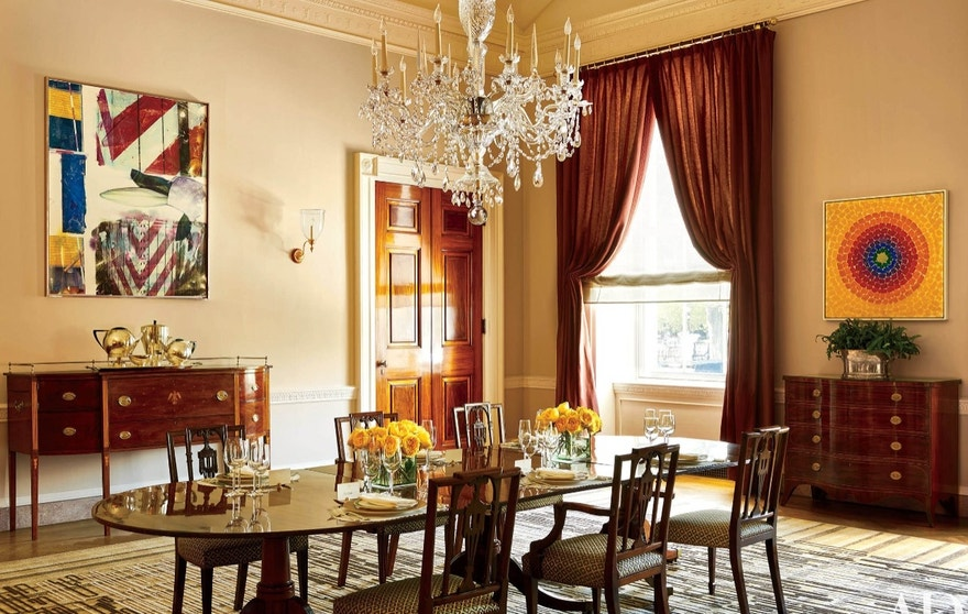 "This photo provided by Architectural Digest show the Old Family Dining room in the White House in Washington. Works by Robert Rauschenberg, right, and Alma Thomas, the first African American artist woman represented in the White House, left, make a modern splash. President Barack Obama likes to say the White House is the ""people's house."" Exclusive photos published by Architectural Digest are giving the public its first glimpse of private areas on the second floor of the White House that Obama, his wife, Michelle, daughters Malia and Sasha and family dogs Bo and Sunny have called home for nearly eight years.(Michael Mundy/Architectural Digest via AP)"