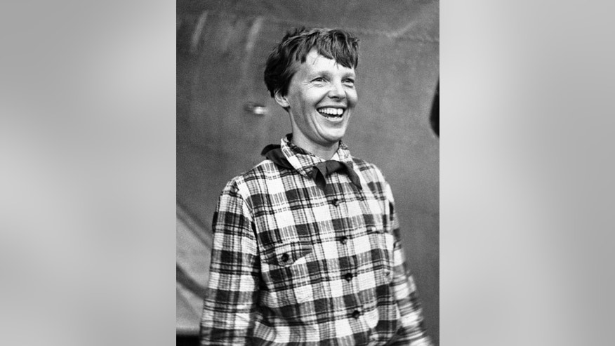 FILE - In this June 6, 1937, file photo, Amelia Earhart, the American airwoman who is flying round the world for fun, arrived at Port Natal, Brazil, and took off on her 2,240-mile flight across the South Atlantic to Dakar, Africa. A group investigating the mystery of what happened to Amelia Earhart announced on Oct. 22, 2016, that it has uncovered another connection between the pioneering female pilot and a body found 76 years ago on a remote Pacific island. (AP Photo, File)
