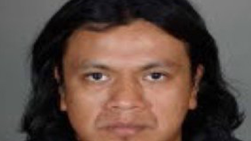 Photo shows Ricardo Augusto Utuy arrested for allegedly stabbing co-worker's daughter in Los Angeles.
