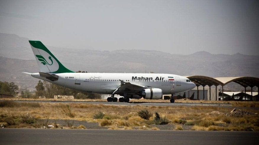 FILE - In this March 1, 2015 file photo, a plane from the Iranian private airline, Mahan Air lands the international airport in Sanaa, Yemen. An Iranian airline backed by the country's notorious Revolutionary Guard has acquired rights to fly commercial routes in more than a dozen European and Asian countries in spite of U.S. terror-related sanctions, the same airline that ferries weapons and fighters to Syria on behalf of President Bashar Assad.  (AP Photo/Hani Mohammed, File)