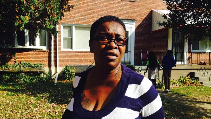 Helen Morgan, mother of Maryland Transit Administration bus driver Ebonee Baker, stands in front of her home in Baltimore, Wednesday, Nov. 2, 2016. Baker was one of five people aboard the MTA bus who died when an oncoming school bus crashed into her bus Tuesday. Morgan said her daughter wanted to be a bus driver since she was a girl and loved the job. (AP Photo/Brian Witte)