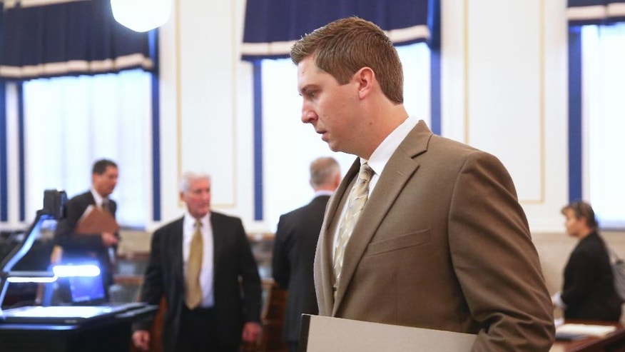 Former University of Cincinnati police officer Ray Tensing walks into the courtroom of Common Pleas Judge Megan Shanahan at the Hamilton County Courthouse, Wednesday, Nov. 2, 2016, in Cincinnati. Tensing is charged with murder of Sam DuBose while on duty during a routine traffic stop on July 19, 2015. (Cara Owsley/The Cincinnati Enquirer via AP, Pool)