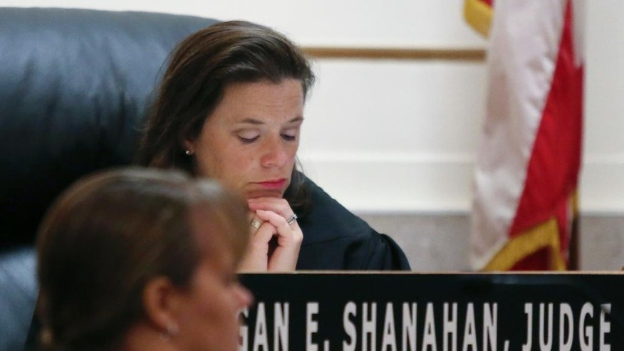 Common Pleas Judge Megan Shanahan reads a transcript while the video interview between Cincinnati Police Dept. Sgt. Shannon Heine and Ray Tensing plays at the Hamilton County Courthouse, Thursday, Nov. 3, 2016, in Cincinnati. Tensing, a former University of Cincinnati police officer, is charged with fatally shooting Sam DuBose during a routine traffic stop in July 2015. (Cara Owsley/The Cincinnati Enquirer via AP, Pool)