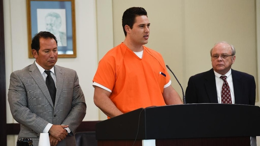Former Vanderbilt football player Brandon Vandenburg, center, speaks at his sentencing hearing Friday, Nov. 4, 2016, in Nashville, Tenn. At left is attorney Albert Perez Jr. and at right is attorney Randall Reagan. Vandenberg is scheduled to be sentenced for his role in the rape of an unconscious fellow student in June 2013. Vandenburg earlier this year became the second former player convicted in the assault on his former girlfriend in a campus dormitory. (George Walker IV/The Tennessean via AP, Pool)