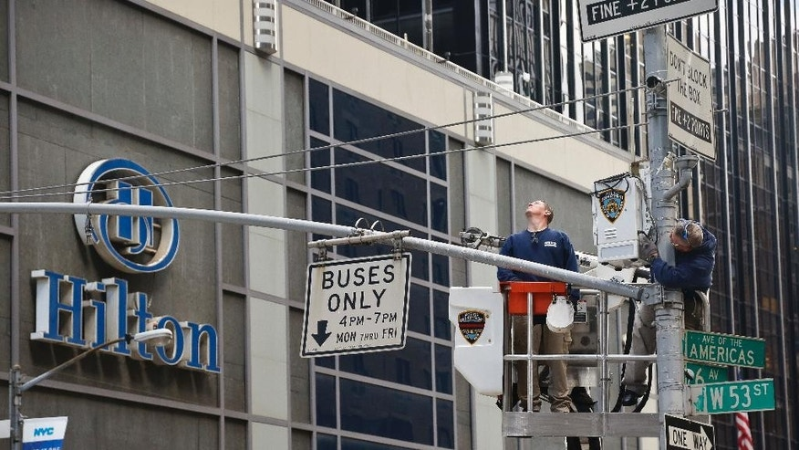 "NYPD install police security camera near the Hilton hotel in New York, Friday Nov. 4, 2016, where Donald Trump organizers will gather on election night.  The FBI and New York Police Department say they are assessing the credibility of information they received of a possible al-Qaida terror attack against the U.S. on the eve of Election Day. Officials say Friday that counterterrorism investigators are reviewing the information that mentioned New York, Texas and Virginia as potential targets. An NYPD spokesman says in a statement the information ""lacks specificity.""  (AP Photo/Bebeto Matthews)"