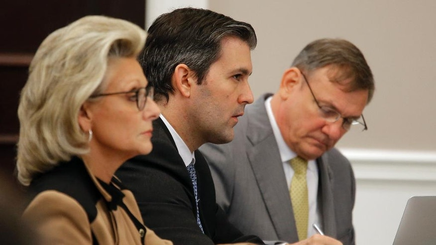Former North Charleston Police Officer Michael Slager, second from right, sits at the defense table in the courtroomduring his trial, Thursday, Nov. 3, 2016 in Charleston, S.C. Slager faces 30 years to life if convicted of murder in the April 2015 death of Scott, whose shooting, captured on a bystander's dramatic cellphone video, spread on social media and stunned the nation. (Grace Beahm/Post and Courier via AP, Pool, File)